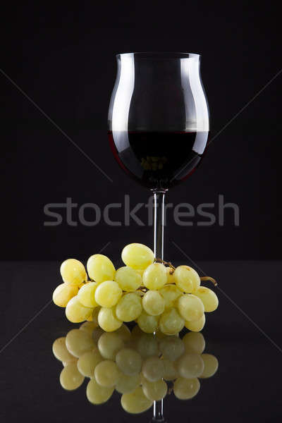 Still Life Of Wine And Grapes On Black Background Stock photo © AndreyPopov