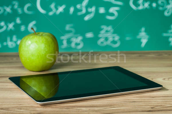 Digital tablet and apple on the desk Stock photo © AndreyPopov