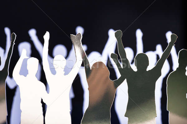 Silhouettes of exited people Stock photo © AndreyPopov