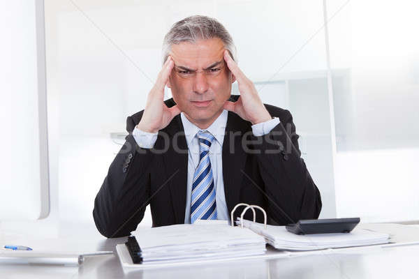 Mature Businessman With Head Ache Stock photo © AndreyPopov