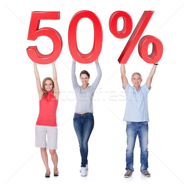 Casual people holding 50% sale sign Stock photo © AndreyPopov