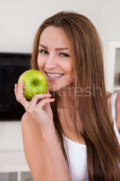 Portrait Of Happy Young Woman Holding Green Apple Stock photo © AndreyPopov