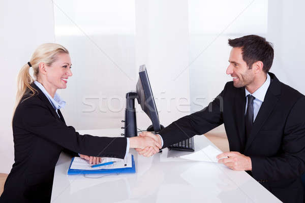 Business man and woman shaking hands Stock photo © AndreyPopov