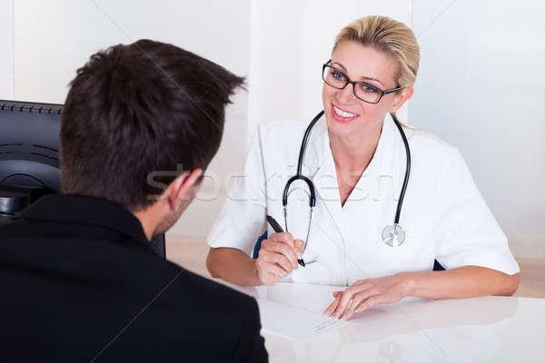 женщины врач Consulting пациент Привлекательная женщина Сток-фото © AndreyPopov