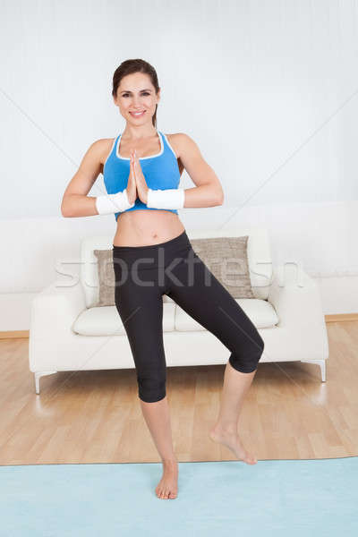 Woman stretching her muscles Stock photo © AndreyPopov
