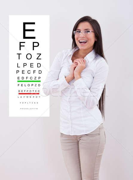 Dama nuevos gafas pie examen de la vista tabla Foto stock © AndreyPopov