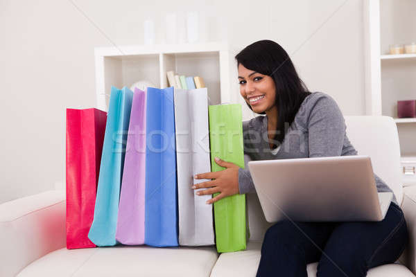 Young Woman Shopping Online Stock photo © AndreyPopov