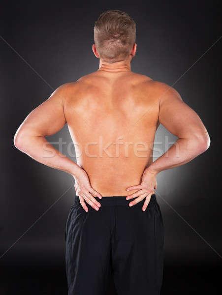 強い 筋肉の 男 腰痛 表示 後ろ ストックフォト © AndreyPopov