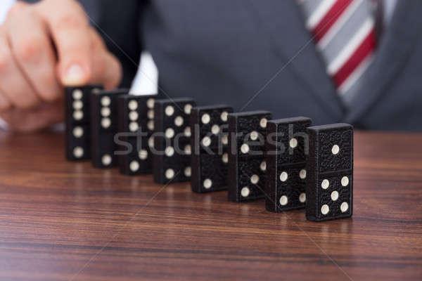 üzletember játszik dominó asztal üzlet kéz Stock fotó © AndreyPopov