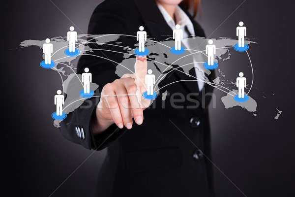 Businesswoman Touching World Map Stock photo © AndreyPopov