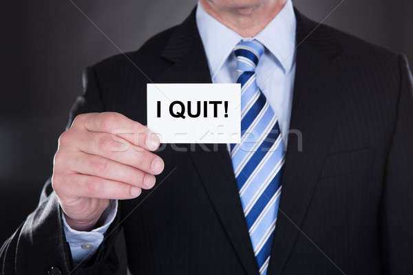 Stock photo: Businessman Showing Card With I Quit Sign