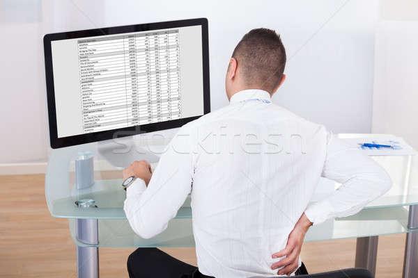 Biznesmen ból w krzyżu biurko widok z tyłu młodych Zdjęcia stock © AndreyPopov