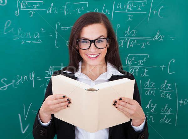 Teacher Reading Book In Classroom Stock photo © AndreyPopov