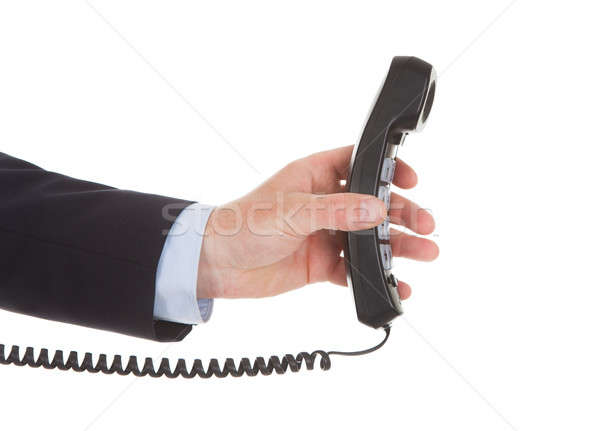 Businessman Holding Telephone Receiver Stock photo © AndreyPopov