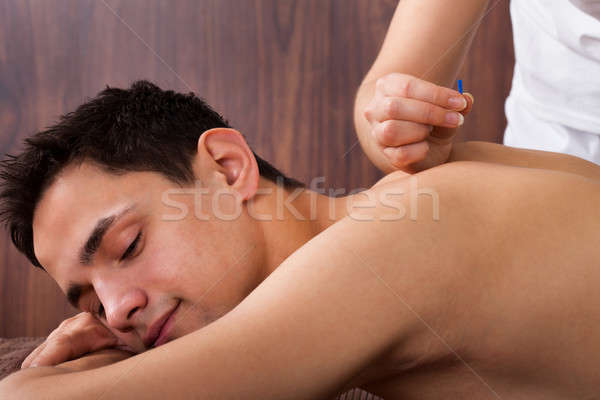 Man Undergoing Acupuncture Treatment In Spa Stock photo © AndreyPopov