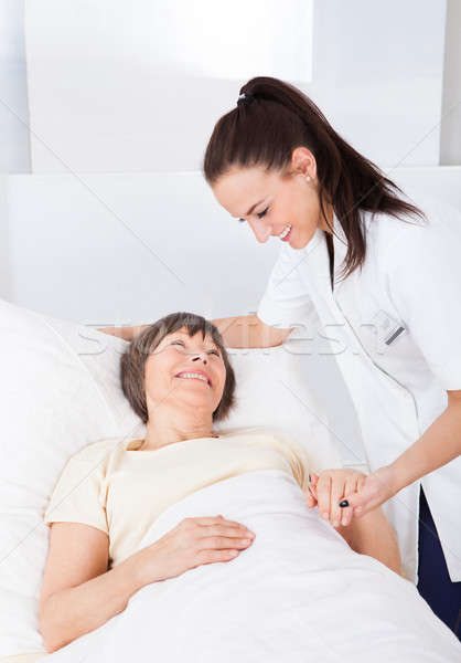 Stock photo: Female Doctor Consoling Senior Woman