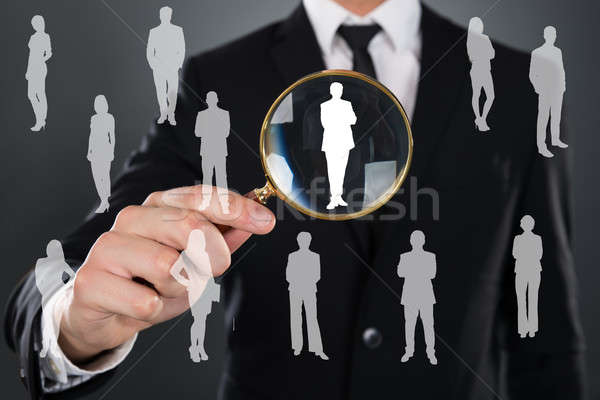 Businessman Searching Candidate With Magnifier Stock photo © AndreyPopov