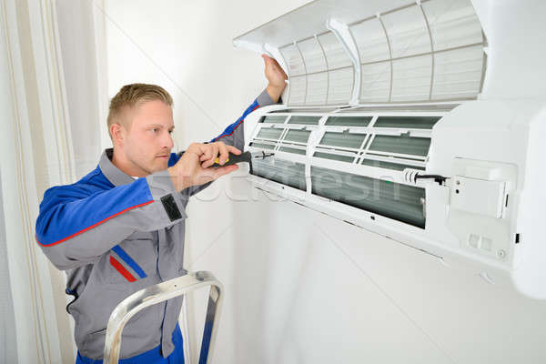 Electrician Repairing Air Conditioner Stock photo © AndreyPopov