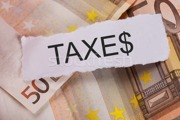 Taxes Sign On Euro Banknotes Stock photo © AndreyPopov
