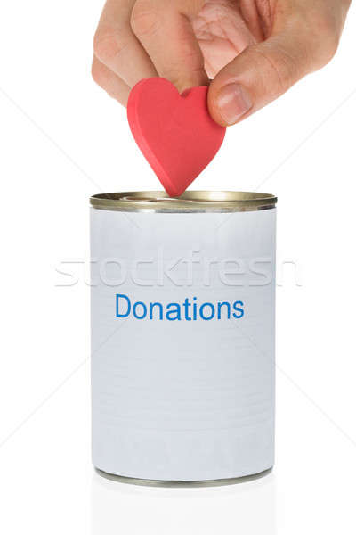 Person Inserting Heart In Donation Can Stock photo © AndreyPopov