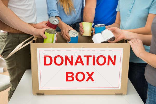 Pessoas doação caixa pessoas do grupo mulher Foto stock © AndreyPopov