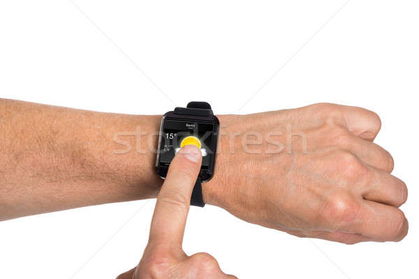 Hand Wearing Smartwatch Showing Weather Condition Stock photo © AndreyPopov