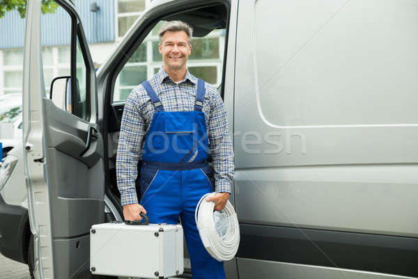 Male Worker With Wire And Toolbox Stock photo © AndreyPopov