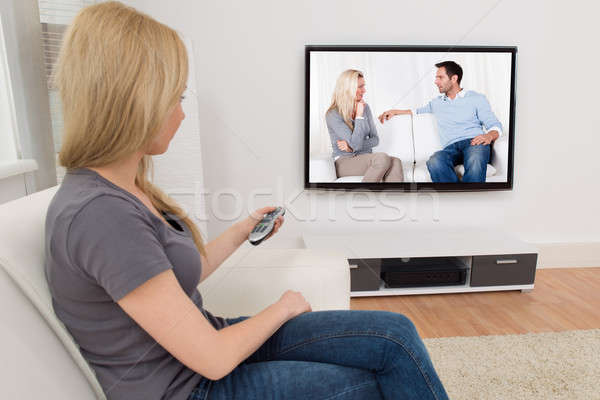 Woman With Remote Control In Front Of Television Stock photo © AndreyPopov