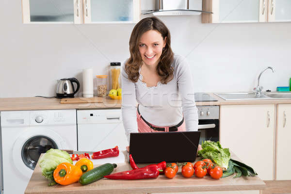 Woman Looking For Recipe On Laptop Stock photo © AndreyPopov