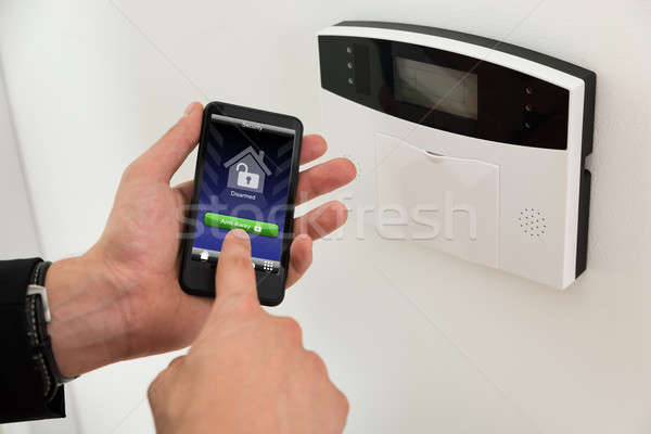 Businessperson Arming Security System Stock photo © AndreyPopov