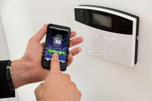 Foto stock: Empresario · seguridad · primer · plano · manos · entrada · teléfono · móvil