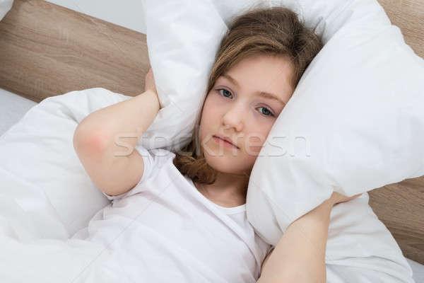 девушки ушки подушкой кровать спальня лице Сток-фото © AndreyPopov
