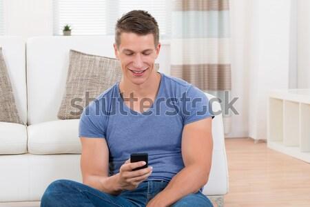 Homem sofá pressão arterial jovem feliz sessão Foto stock © AndreyPopov