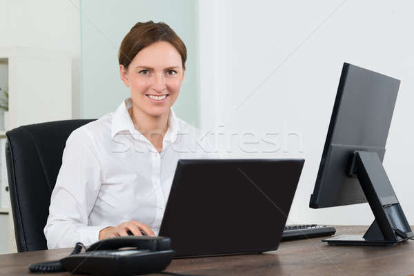 Businesswoman Working On Laptop And Desktop Computer Stock photo © AndreyPopov