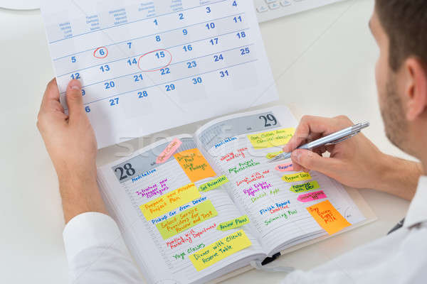 Businessman With Calendar And Diary Stock photo © AndreyPopov