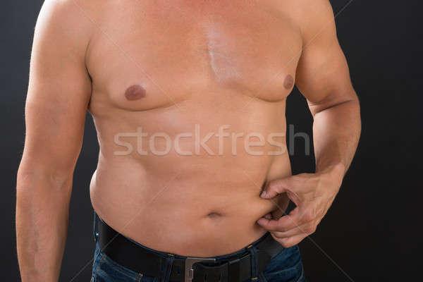 Półnagi człowiek żołądka tłuszczu szary Zdjęcia stock © AndreyPopov