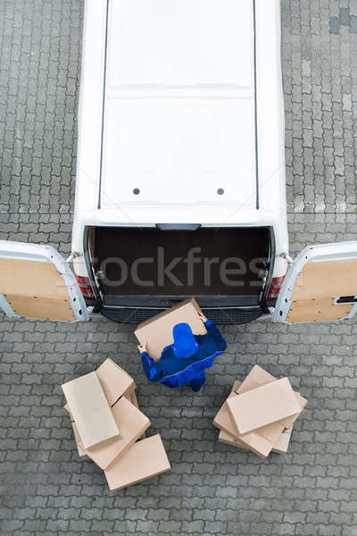 Delivery Man Unloading Cardboard Boxes From Van On Street Stock photo © AndreyPopov
