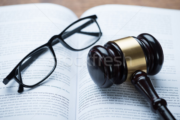 Mallet And Eyeglasses On Open Legal Book Stock photo © AndreyPopov