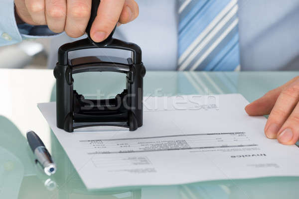 Person's Hand Stamping Document At Office Desk Stock photo © AndreyPopov
