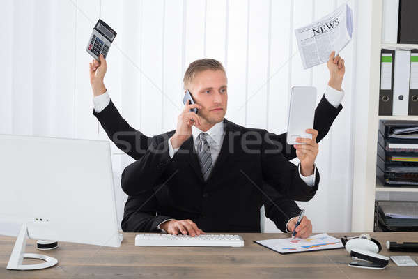 Businessman Multitasking Stock photo © AndreyPopov