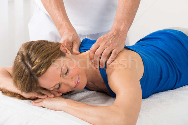 Stock photo: Person Giving Massage To Woman