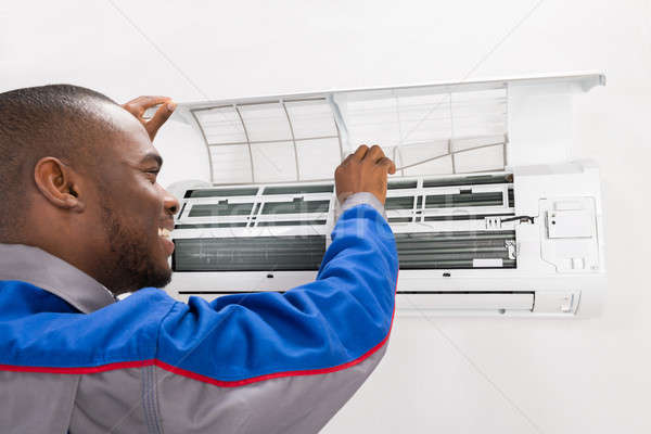 Stock photo: Technician Checking Air Conditioner