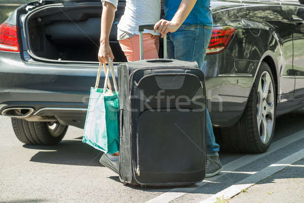 Couple Putting Luggage In A Car Trunk Stock photo © AndreyPopov