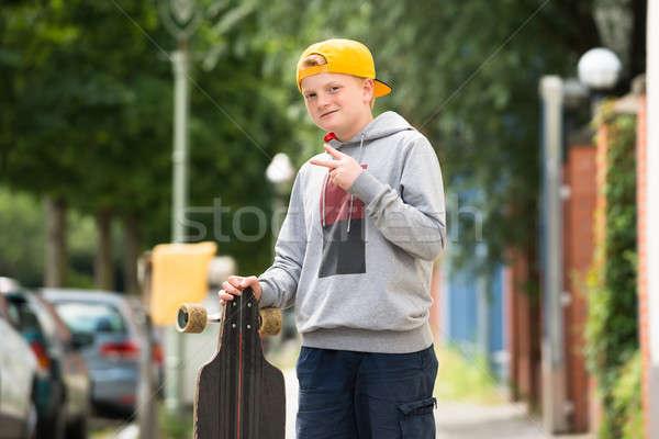 Portrait Of A Boy With Skateboard Stock photo © AndreyPopov