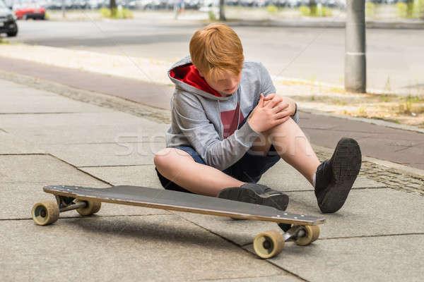 Boy Looking At His Injured Leg Stock photo © AndreyPopov
