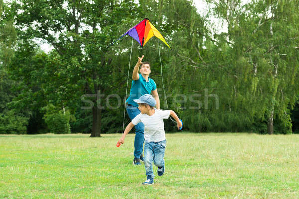 Father Launching The Kite Hold By His Son Stock photo © AndreyPopov