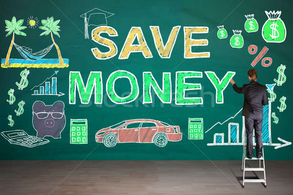 Businessperson Drawing Save Money Concept On Diary Stock photo © AndreyPopov