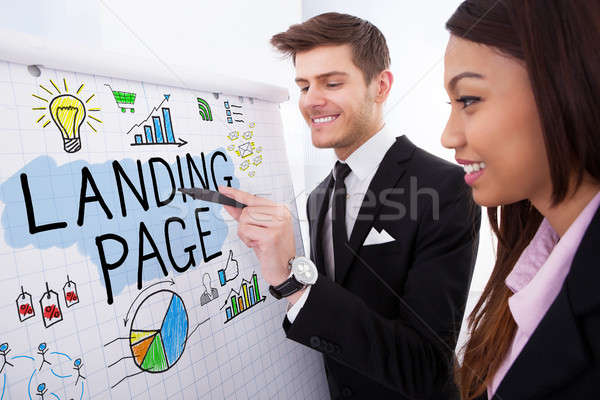 Businesspeople Discussing Landing Page On Flipchart Stock photo © AndreyPopov