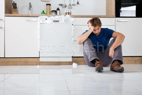 Adam oturma bulaşık makinesi üzgün genç köpük Stok fotoğraf © AndreyPopov