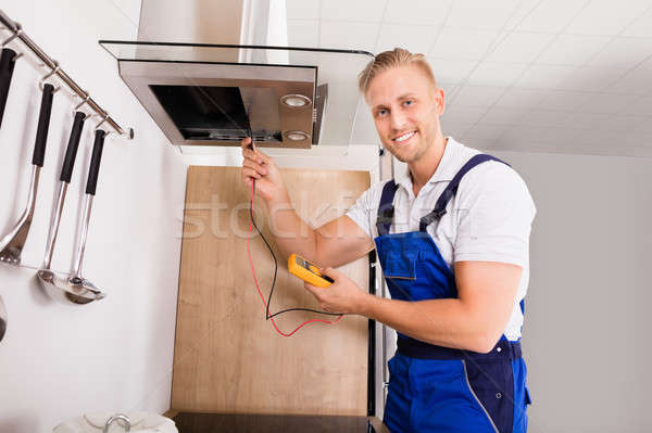 Técnico cozinha filtrar jovem masculino digital Foto stock © AndreyPopov